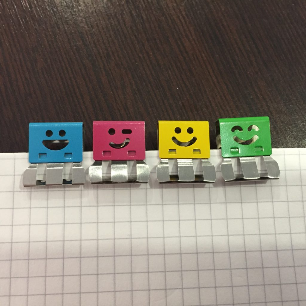 Colourful paperclips with cheerful expressions